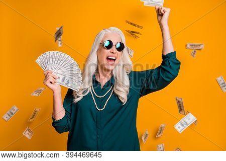 Photo Of Funky Grandma Lady Hold Fan Usa Bucks Money Fall From Sky Wealthy Rich Person Freelance Job