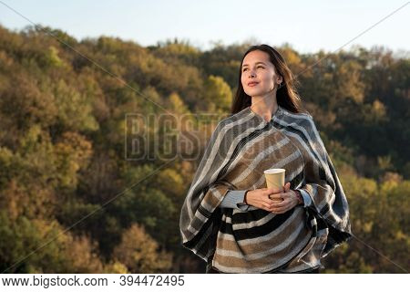Cute Girl On Nature Background With A Cup Of Coffee. Woman Looking Into Distance Thoughtfully