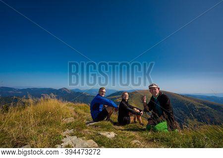 Adult Tourists Family Trekking In Autumn Woods, Photo Taken In Slovakian Velka Fatra Mountains, Path