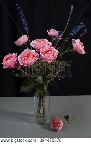 Peony Pink Roses In A Glass Vase On A Dark Background