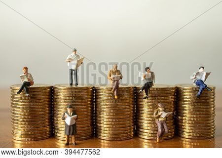 Business, Money Investment And Planning Concept.  Group Of Businessman Miniature Figure People Figur