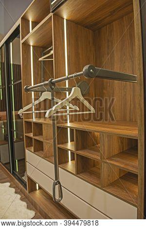 Interior Design Decor Furnishing Of Luxury Show Home Bedroom Showing Wooden Wardrobe Closet Furnitur