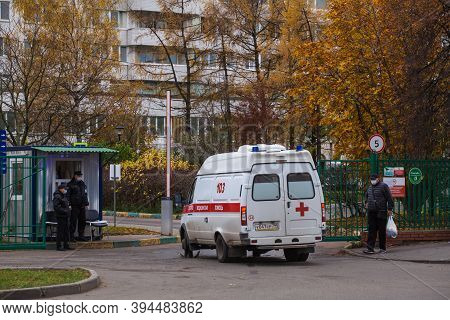 Moscow, Russia - October 26 2020: An Ambulance Is Driving Into The Hospital Grounds. Two Guards And