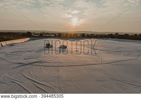 Water Resistant Tpo Membrane Positioned On The Roof. Pvc And Rubber Membrane