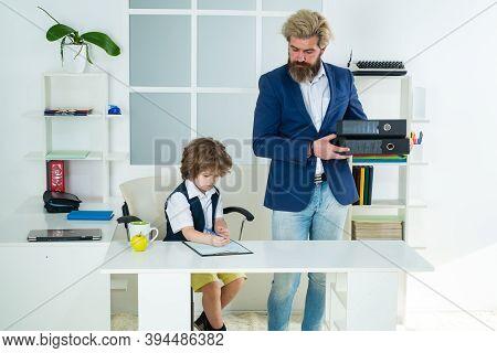 Little Boss. Little Businessman Bossy Child Working In Office