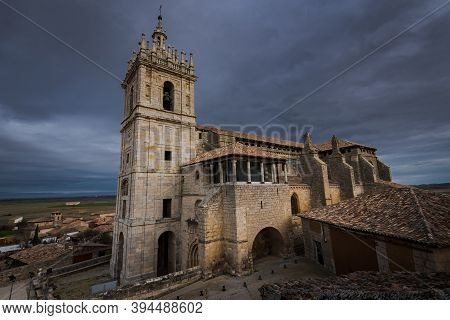 Old Gothic Style Catholic Church Lateral View With A Dramatic Sky