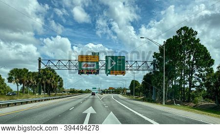 A Toll Road Sign That Designates Where People Should Drive To Pay Tolls For Epass And Sunpass In Orl