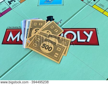Money For The Game Monopoly By Hasbro On A White Background.