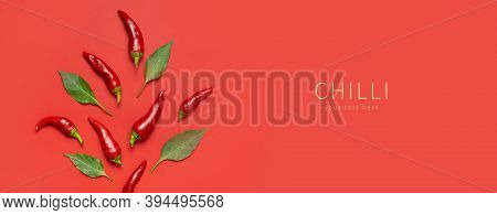 Hot Red And Green Fresh Chili Peppers On Red Background Flat Lay Top View Copy Space. Seasoning For