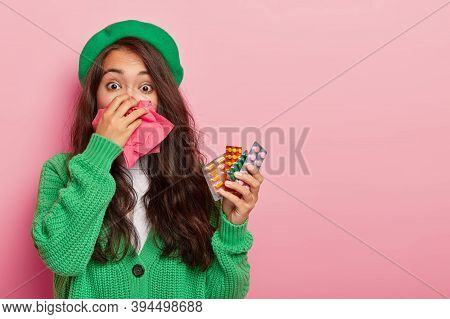 Sick Asian Woman Caught Cold During Wet Autumn Day, Has Running Nose, Holds Various Pills For Curing