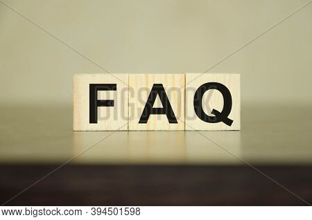 Wooden Blocks With The Word Faq On A White Table That Lie On A Black Table. Frequently Asked Questio