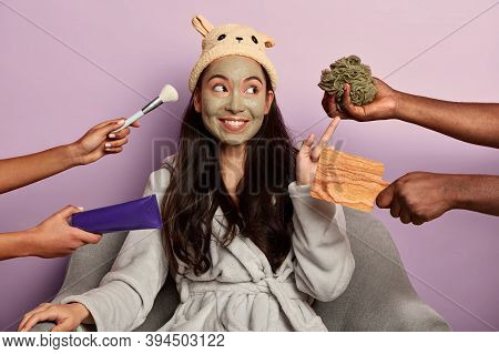 Young Millennial Girl Applies Organic Facial Mask On Face After Taking Shower, Does Beauty Wellness