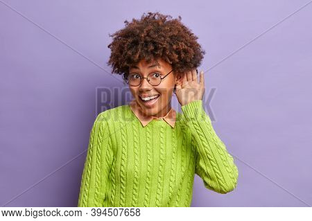 Happy Curious Dark Skinned Woman Holds And Near Ear And To Overhear Interesting Informaion Wears Cas