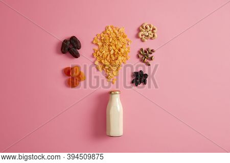 Healthy Breakfast Granola. Cereals With Bottle Of Fresh Milk, Dried Fruits And Nutrient Nuts To Prep