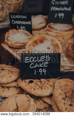 View Through The Window Of Fresh Eccles Cakes On A Retail Display Of A Bakery In Frome, Uk, Shallow