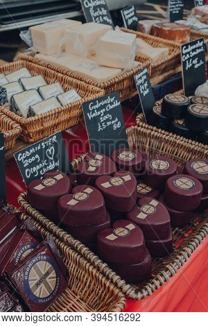 Frome, Uk - October 07, 2020: Variety Of Local Cheeses On Sale At A Street Market In Frome, A Market