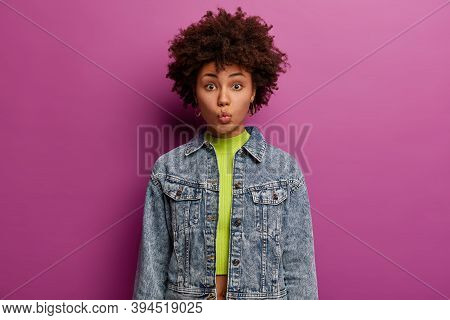 Human Facial Expressions Concept. Pretty Dark Skinned Millennial Girl Keeps Lips Rounded, Going To K