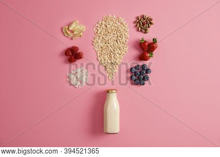 Uncooked Oat With Dried Apples, Coconut Flakes, Pistachio And Appetizing Ripe Harvested Fruits, Bott