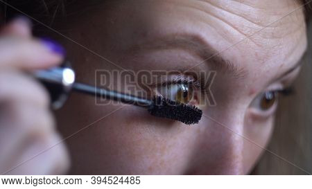 Close Up Of Beautiful Young Woman Applying Mascara For Lash Extension. Media. Face Of Attractive Gir