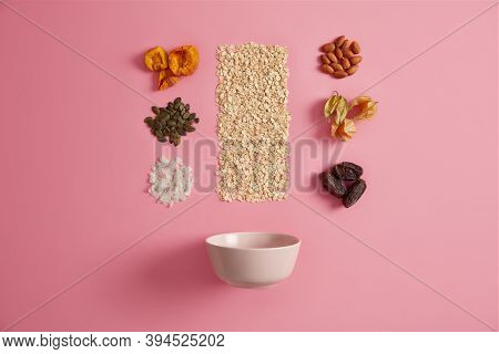 Ingredients For Cooking Healthy Breakfast. Oatmeal, Dried Apricot, Physalis, Dates, Pumpkin Seeds, A