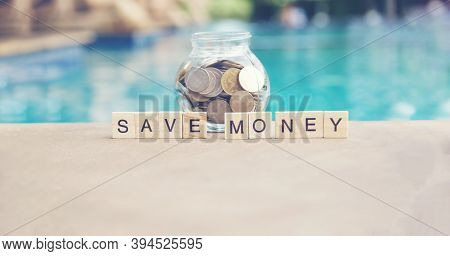 Coins In Glass Jar For Money Saving Financial Concept. Money Saving For The Future Concepts.