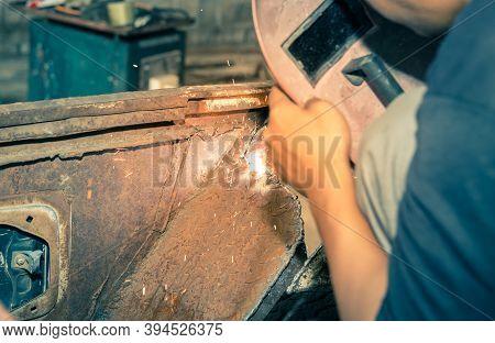 Welding Man Welding Car Mudguard Or Construction In Garage By Electrode Arc Welding Technique In Vin
