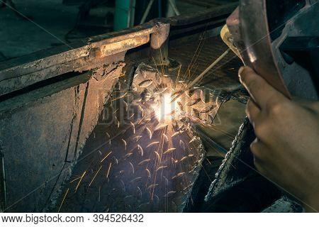 Welding Spark Of Car Mudguard From Welder In Car Repair Shop In Zoom View In Vintage Tone