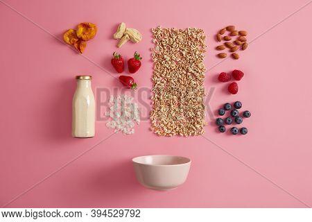 Tasty Healthy Natural Ingredients For Breakfast On Pink Background. Fresh Milk In Bottle, Bowl, Flak