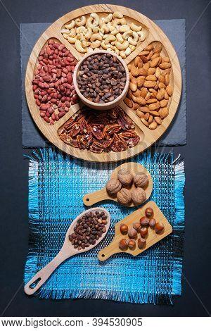 Assortment Of Nuts. Hazelnuts, Walnuts, Pecans, Peanut, Almond Walnuts Food Mix Background Top View