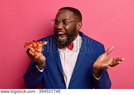 Hungry Black Man Bites Very Big Piece Of Pizza, Has Appetite, Wears Formal Clothing And Spectacles P