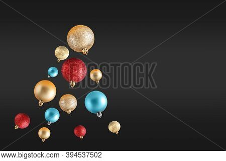 Creative Original Christmas Tree Made Of Gold, Red And Blue Christmas Balls On Black Background. Min