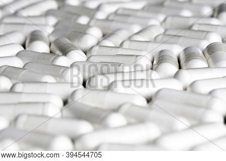 Heap Of White Pills On A White Background, Healthcare And Medicin
