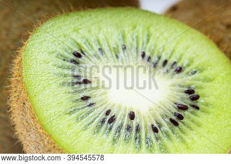 Close Up Of A Healthy Kiwi Fruit, Macro Studio Shot Of Green Kiwi