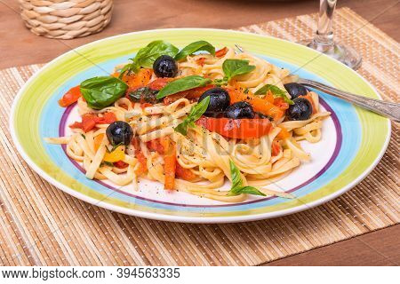 Vegetarian Pasta With Vegetables, Linguine With Bell Pepper, Tomatoes And Olives On A Plate Standing