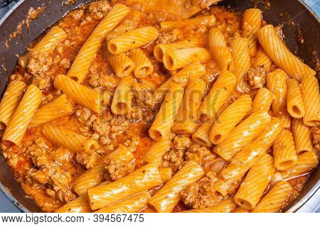 Cooking Tortiglioni With Onion And Sausage Ragout, Pasta With Sausage Sauce With Onions And Tomato P