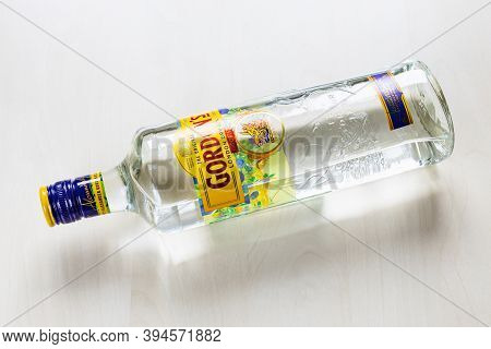 Moscow, Russia - November 4, 2020: Top View Of Lying Bottle Of Gordon's London Dry Gin On Light Brow