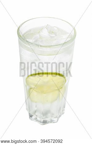 Gin And Tonic Cocktail In Highball Glass With Two Slices Of Lime And Ice Cubes Isolated On White Bac