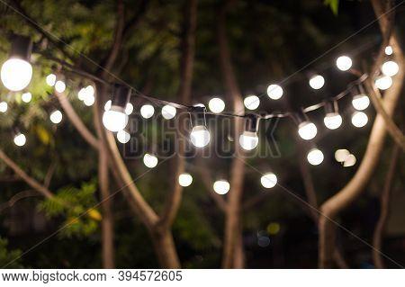 Blurred Background, Backyard Illumination, Light In The Evening Garden, Electric Lanterns With Round
