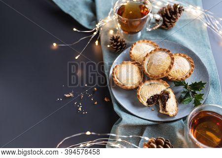 Mince Pies On A Plate Served With Black Tea Shot From Above With Copy Space. A Mince Pie Is A Tradit