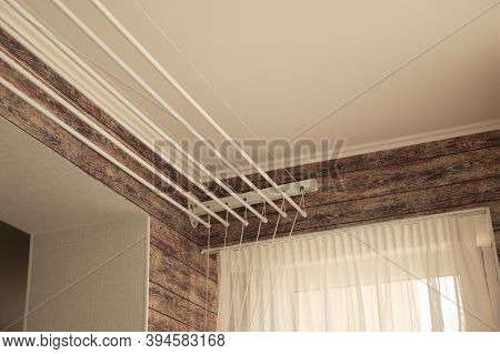 A Ceiling Linen Drayer Hanger In The Interior Of The Modern Room