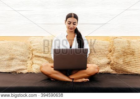 Young Female With Portable Net-book In Modern Coffee Shop During Recreation Time, Charming Woman Usi
