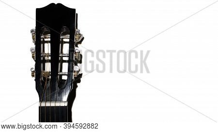 Guitar Fretboard On A White Background Close-up. Classical Acoustic Guitar, Copy Space