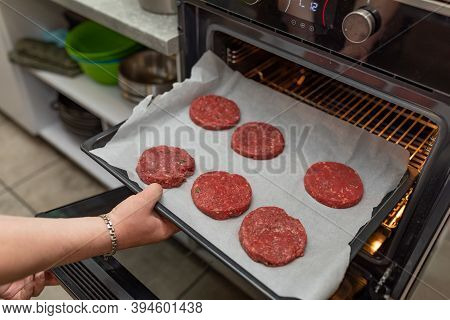 Female Hands Make Meatballs In The Oven. American Meatballs For Burgers. Homemade Fried Beef Patties