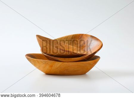 Empty handcrafted natural wood bowls