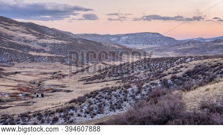 dusk over a mountain valley at Colorado foothills in fall scenery - Red Mountain Open Space, recreational area maintained by Larimer County