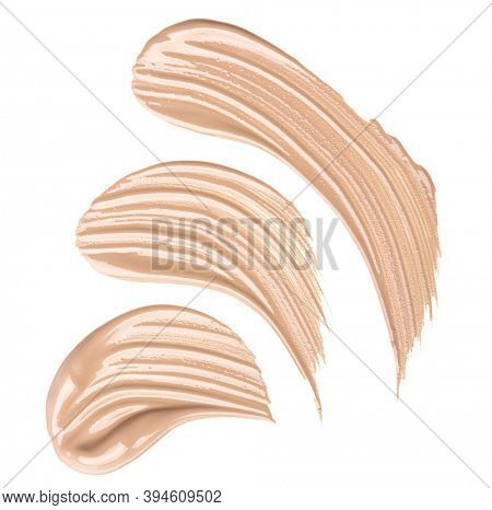 Smears of foundation for face.A smears of lipstick. Cosmetic smears of liquid. Samples of blush for the face.