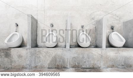 Men's Room With White Porcelain Urinals In Line. Modern Clean Public Toilets With Tiles . Comfort Ma