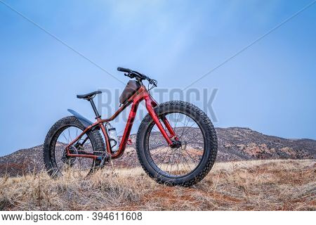 fat mountain bike at Colorado foothills in fall scenery - Red Mountain Open Space north of Fort Collins