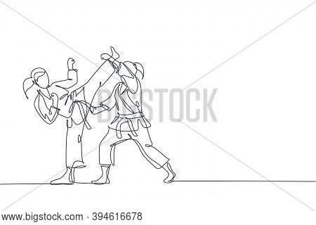 One Continuous Line Drawing Of Two Young Talented Karateka Girls Train Pose For Duel Fighting At Doj