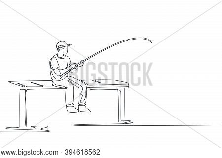 Single Continuous Line Drawing Of Young Happy Fisher Man Fishing Big Trout Fish In Dock Pier While S